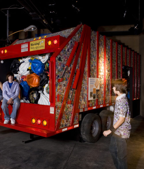 Children around a garbage truck exhibit inside the Springs Preserve, designed by LGA Architecture.