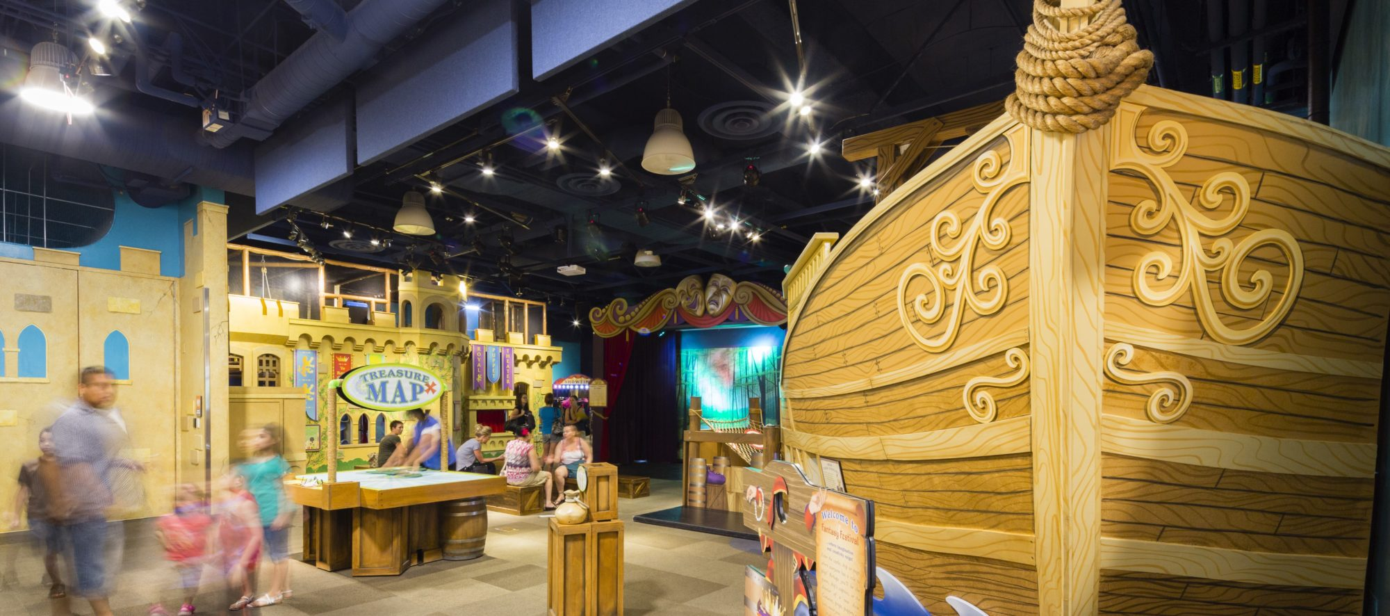 Children enjoying the exhibits at the DISCOVERY Children's Museum, designed by LGA Architecture.