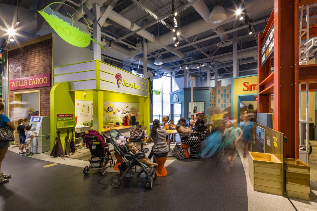 Children and adults enjoying the exhibits at the Discovery Children's Museum, designed by LGA Architecture.