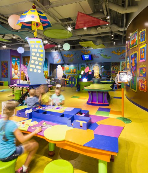 Children and adults enjoying the games at the Discovery Children's Museum, designed by LGA Architecture.