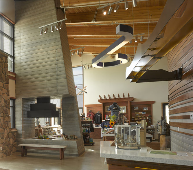 Retail area and fireplace inside of the Spring Mountains Visitor Gateway, masterplan and design by LGA Architecture.
