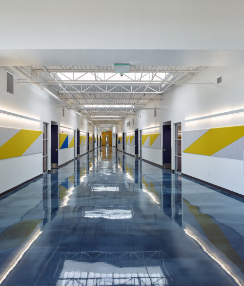 A hallway of the Cristo Rey St. Viator College Preparatory School, education design by LGA Architecture.