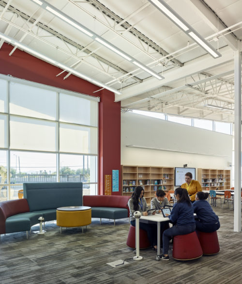 Children in the library at the Cristo Rey St. Viator College Preparatory Academy, education design by LGA Architecture.