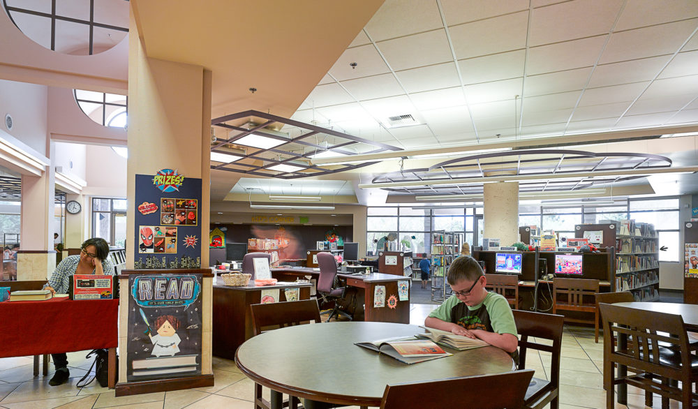 A child reading inside the Aliante Library, designed by LGA Architecture.