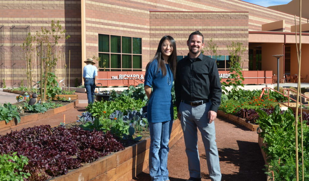 Alexia Chen and Lance Kirk of LGA Architecture, standing in front of the Ruffin Organic Gardens, Alexander Dawson School at Rainbow Mountain.