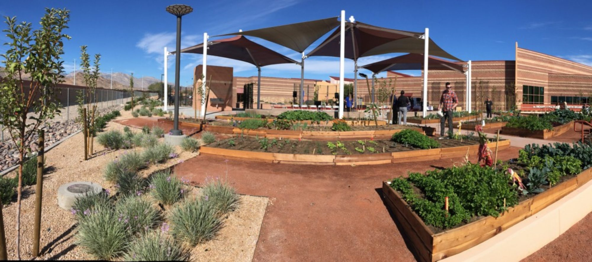 A panoramic view of the Ruffin Organic Gardens, Alexander Dawson School at Rainbow Mountain designed by LGA Architecture.