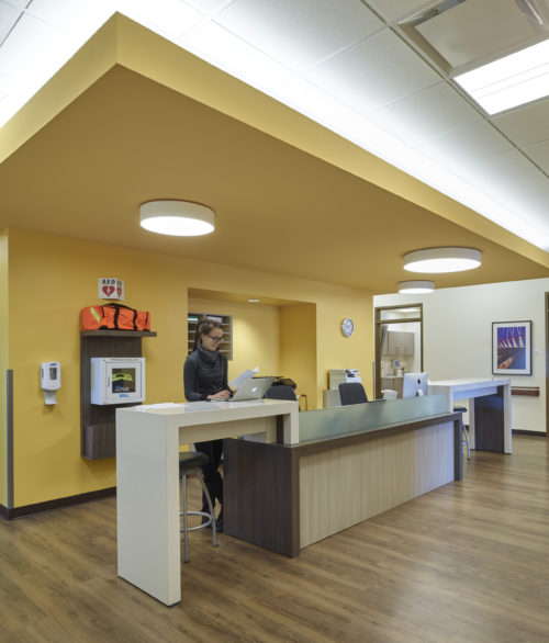 A reception desk at a Iora Health Clinic, renovated and designed by LGA Architecture
