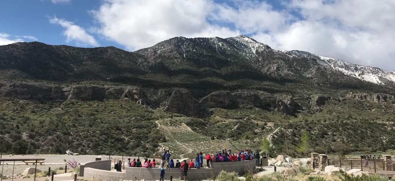 People gathered in one of the exterior amphitheaters at the Spring Mountains Visitor Gateway, designed by LGA Architecture.